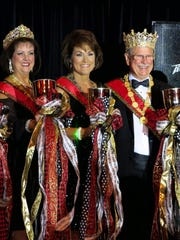 Krewe Gemini Queen XXIX Sue Cooksey, Captain Tracy Herrin, King Herb Doughty are in the spotlight after their coronation.