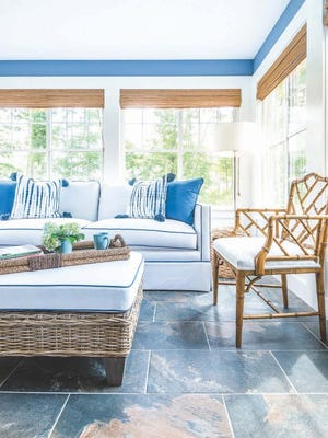 To create a coastal look without the cliches, Ally Maloney advocates mixing natural materials like slate and wicker with a white and blue palette.