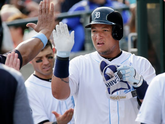 Tigers first baseman Miguel Cabrera celebrates in the dugout after hitting a solo home run during the sixth inning of the Tigers' 3-2 loss Saturday at Comerica Park.