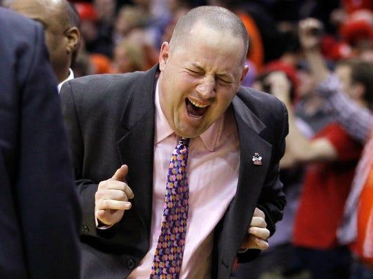 Marquette coach Buzz Williams celebrates after his