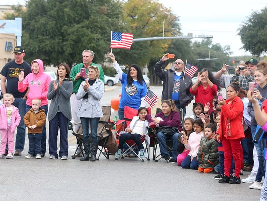 Spectators cheer for veterans and participants in the