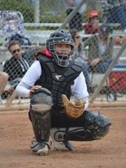 Jade Ignacio takes her position behind home plate. Jade is the granddaughter of Eddie Aguon, a former Guam Major League player.