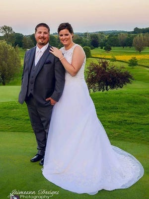 Ryan Koll and Amber Bertard Koll were married Aug. 19. Their box of hundreds of wedding cards was stolen from their vehicle after the reception, held at Mayville Golf Course. A $500 reward is being offered for any information.
