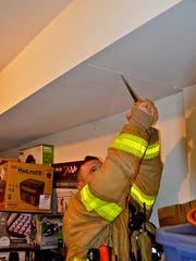 Firefighters had to pry open the drywall to get Snickers