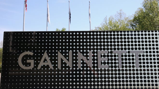 A sign in front of Gannett Co Inc, headquarters is shown, on April 25, 2016 in Tysons Corner, Virginia.