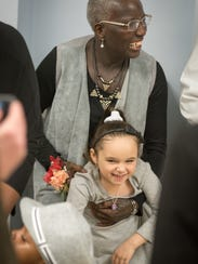 Karen Mitcham, Freehold, laughs with her newly-adopted
