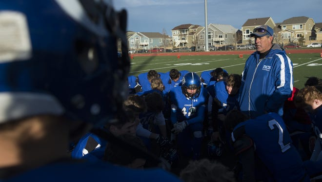 Resurrection Christian coach Mark Roggy speaks to his team after a game last season. The Cougars are moving up to 2A after making the 1A semifinals each of the last two seasons.