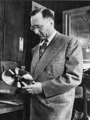 "Jim Bulleit, whose firm sprang to great renown following ""Near You"" -  -Photo published in The Tennessean Magazine, page 6, 3/28/1948. Photographer unknown. Bulleit is shown holding a record in what appears to be a workshop. Scanned from original magazine."