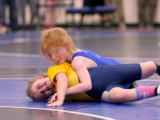 Holly Wasche of Port Angeles, right, grapples with
