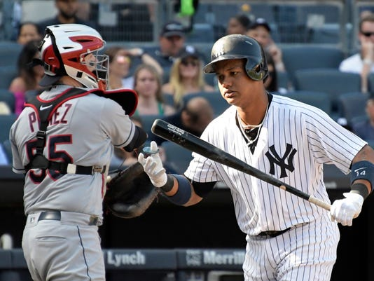 New York Yankees pinch hitter Starlin Castro, reacts after striking out as Cleveland Indians catcher Roberto Perez returns the ball to the pitcher during the ninth inning in the first game of a baseball doubleheader Wednesday, Aug. 30, 2017, at Yankee Stadium in New York. (AP Photo/Bill Kostroun)