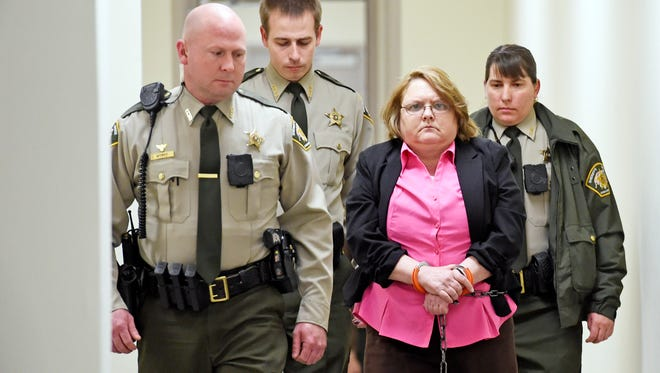 Found guilty of Capital Murder, Joyce Hardin Garrard is led back to the Etowah County Detention Center in Gadsden, Ala. on Friday, March 20, 2015. After  more than three hours of deliberation an Etowah County jury found Garrard guilty of capital murder in the death of 9-year-old granddaughter, Savannah Hardin.  (AP Photo/ Gadsden Times, Eric T. Wright)