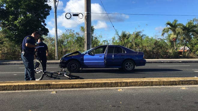 Police on the scene involving a car and a bicycle on Marine Corps Drive in Dededo on June 2, 2016.