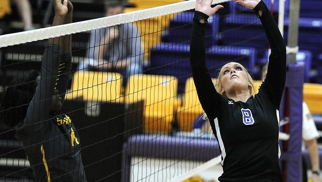 Wylie's Ever Hayes (8) tips the ball over the net during the third game of the Lady Bulldogs' win over Snyder on Oct. 18 at Wylie High School.
