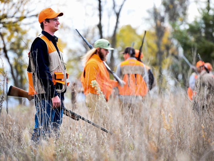 Austin Nachtigall (left) and a group of hunters survey