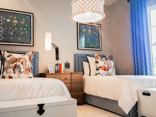 A model bedroom in Sarasota designed by Beasley and