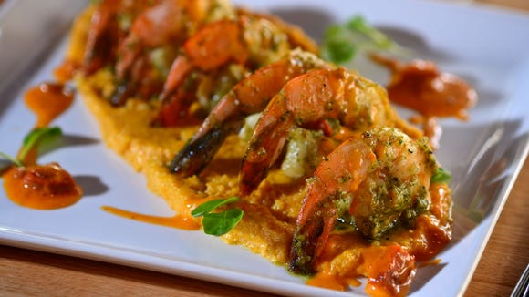 The Fat Snook in Cocoa Beach, which is known for its inventive take on fresh, local seafood, such as this Poblano Pesto Shrimp with pumpkin cheddar grits and chorizo cream sauce, is moving into a bigger location in downtown Cocoa Beach in early 2017.