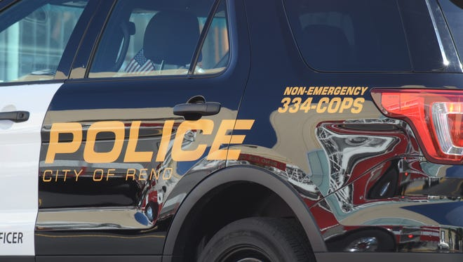 A Reno Police Department vehicle parked at a crime scene.