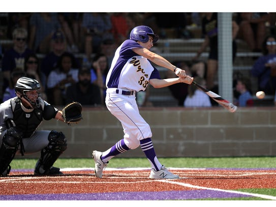 Wylie's Sam King (33) hits a ball during the bottom