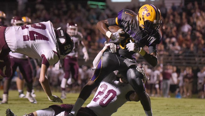 Purvis wide receiver Cj Bolar catches the ball for a touchdown against East Central High School on Friday at Purvis High School.