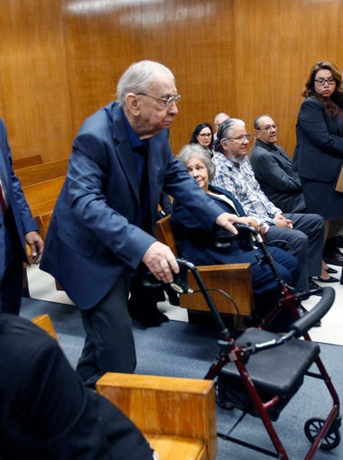 John Bernard Feit enters the 92nd state District Court with his attorney O. Rene Flores (left) before the start of Feit's trial for the murder of Irene Garza Nov.30, 2017, at the Hidalgo County Courthouse in Edinburg, Texas. Former Catholic priest Feit is accused of murdering Irene Garza in April of 1960.