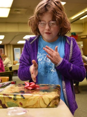 "Ashlinn Keel takes pride in her gift wrapping skills during a past Children's Christmas Store at Bay View Lutheran Church in Sturgeon Bay. The Door County 4-H program returns with ""stores' Nov. 18 at Bay View Lutheran and Nov. 25 at the Bertschinger Center in Egg Harbor."