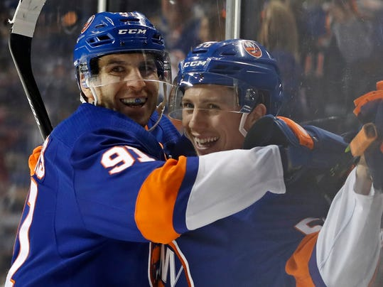 New York Islanders center John Tavares (91) celebrates with teammate Tanner Fritz (56) after Fritz scored his first career NHL goal during the second period of an NHL hockey game against the Minnesota Wild in New York, Monday, Feb. 19, 2018. (AP Photo/Kathy Willens)