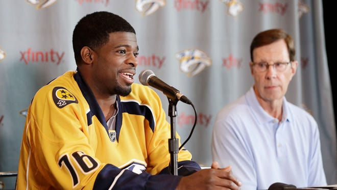 Predators general manager David Poile, right, attends a news conference July 18 introducing defenseman P.K. Subban after a trade with the Canadiens for Shea Weber.
