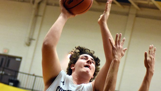 Hendersonville senior Jordan Amis elevates for an interior shot during Thursday's contest against Westmoreland. Amis finished with seven points in the Commandos' 54-51, overtime victory.