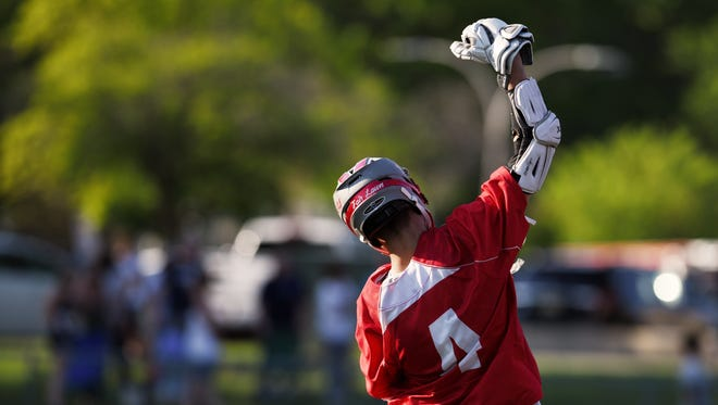 Fair Lawn's Joe Covino (4) tied the school single-season record with 77 goals and broke the record with 107 points during a game against Paramus on Wednesday May 17, 2017