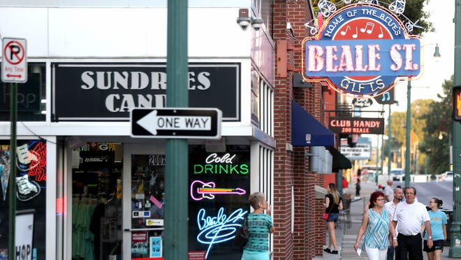 Tourists visit Beale Street in the Memphis downtown tourism development zone in this 2006 file photo.