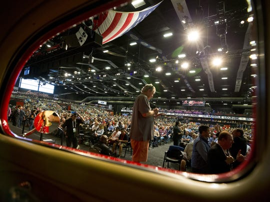 Car enthusiasts gather during the Barrett-Jackson auto