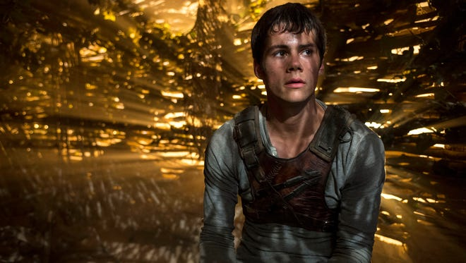 """In this image released by 20th Century Fox, Dylan O'Brien appears in a scene from the film, """"The Maze Runner."""""""