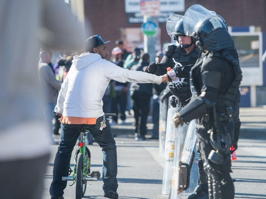 A man fist bumps in support law enforcement forming