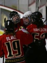 The Binghamton Jr. Senators celebrate a goal by captain
