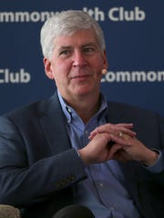 Michigan Gov. Rick Snyder participates in a panel at