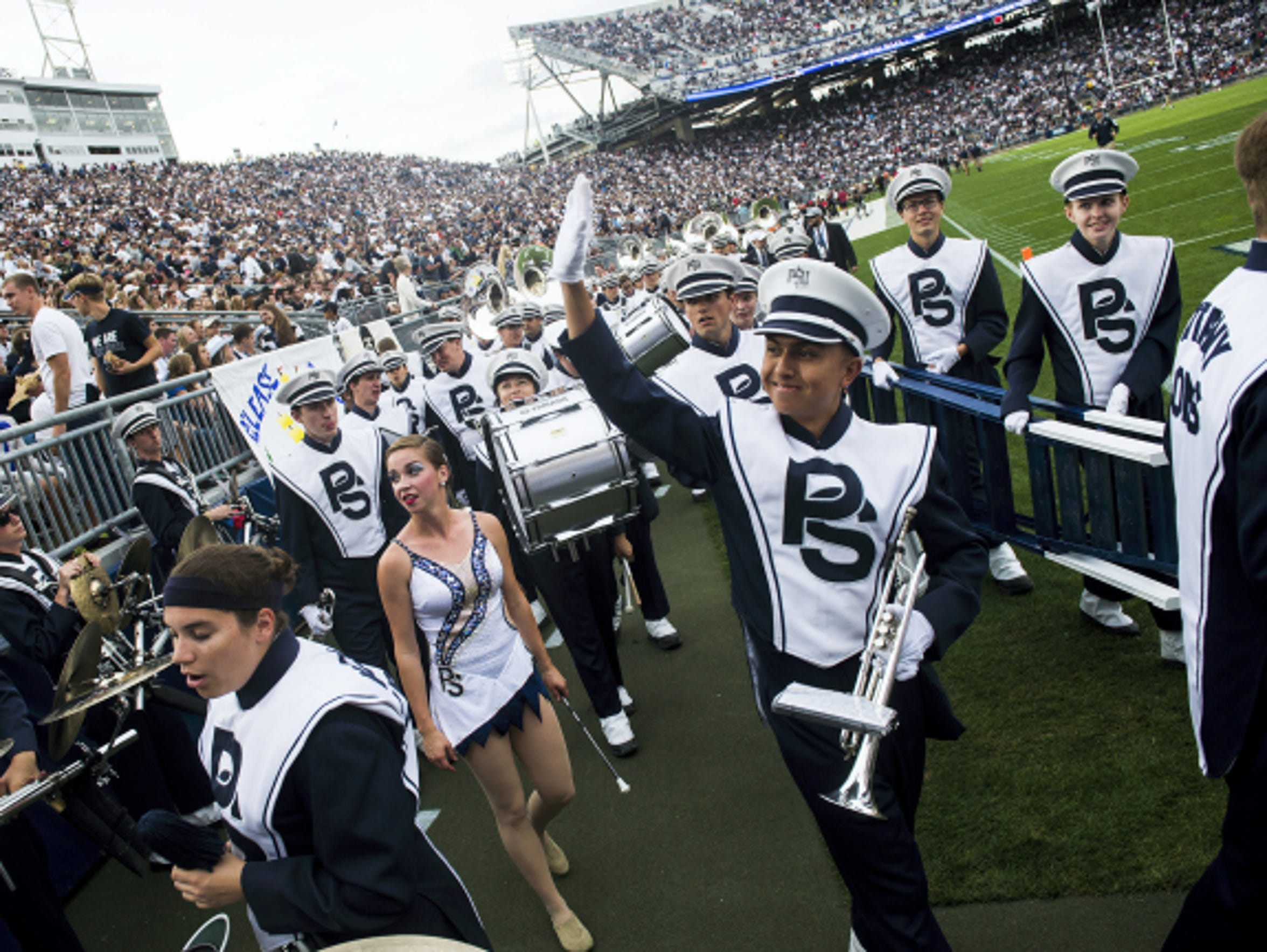 Members of the Penn State Blue Band wave to the audience