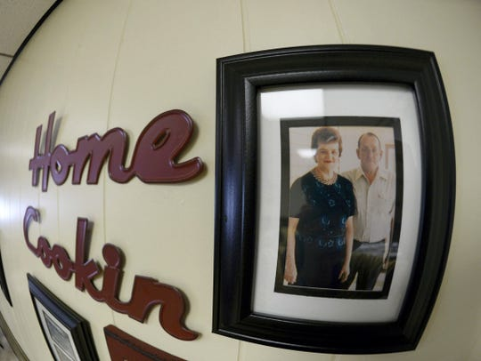 A photo of Fran and Allen (Bob) Schwalm hangs on a