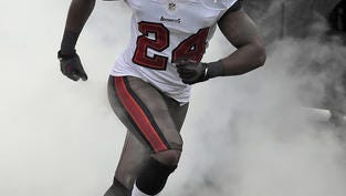 The Tampa Bay Buccaneers parted ways with Darrelle Revis, releasing the five-time Pro Bowl cornerback Wednesday after being unable to trade him and his $16 million annual salary.