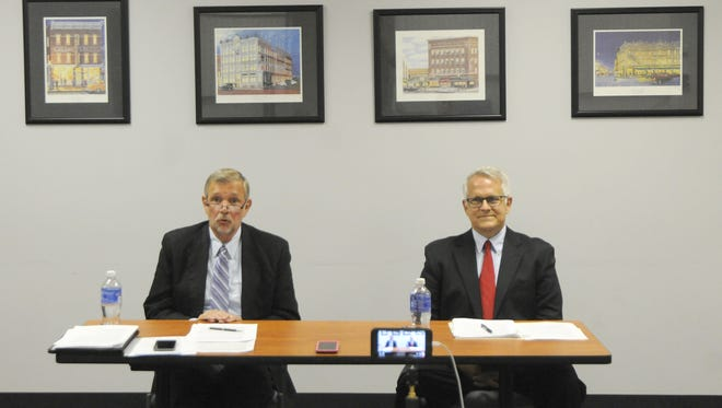 Mayoral candidate Ron Abrams (left) and Mayor Tim Theaker debate one another Tuesday at the News Journal.