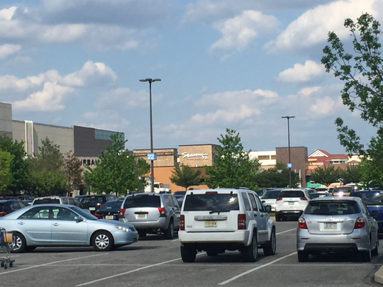 A 52-year-old shopper was groped and robbed as she walked to her vehicle outside the Cherry Hill Mall, police say.