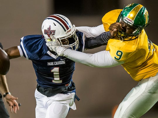 Park Crossing quarterback Cameron Taylor (1) is stopped by Carver's Ja'Colby Givan (9) at Cramton Bowl in Montgomery, Ala. on Friday October 6, 2017. Given was called for a facemark on the play.