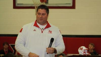 La Salle football coach Nate Moore led the Lancers to the state title in December.