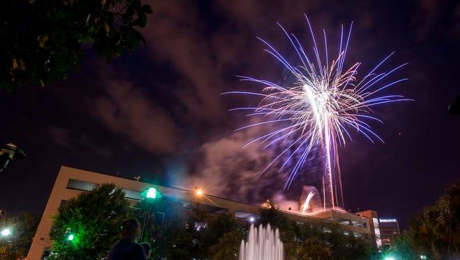 Spectators in Parc Sans Souci watch fireworks during Uncle Sam's Jam in downtown Lafayette, La., Saturday, July 4, 2015.