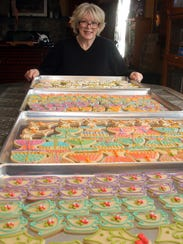 Christine Suhre-Garza with trays of holiday cookies, while in the kitchen of her Poughquag home Nov. 15, 2017.