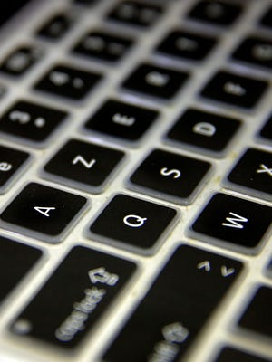 "An AZERTY keyboard is pictured in Paris, Friday, Jan. 22, 2016. France's government is putting out a call for a standardized computer keyboard to replace the multitude of AZERTY models now on the market, saying the current options make it ""nearly impossible to write French correctly with a keyboard sold in France. (AP Photo/Christophe Ena) ORG XMIT: ENA125"
