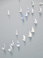 The race fleet waits for wind at the start of the Port Huron to Mackinac Island Sailboat Race on Saturday, July 14, 2018.