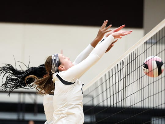 Ankeny Centennial junior Rachel Schon (20) blocks the shot as the Sioux City East Black Raiders battles against the Ankeny Centennial Jaguars during the Class 5A regional final volleyball match at Ankeny Centennial High School on Monday, Oct. 30, 2017.