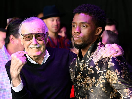 "Comic book legend Stan Lee, left, creator of the ""Black Panther"" superhero, poses with Chadwick Boseman, star of the new ""Black Panther"" film, at the premiere at The Dolby Theatre on Jan. 29, 2018, in Los Angeles."