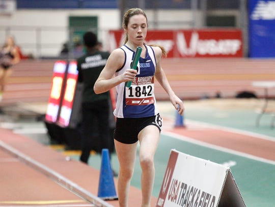 Ursuline's Anna Flynn runs the 4x800-meter relay at
