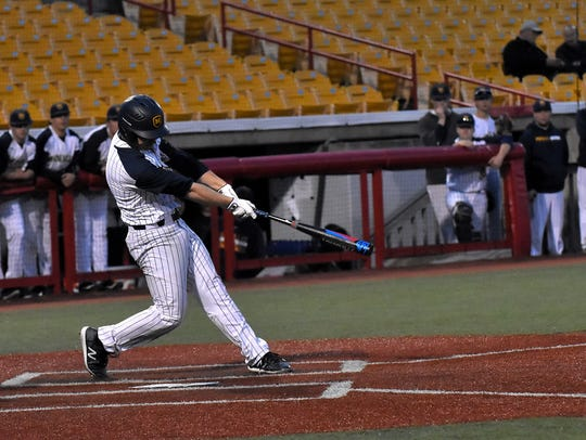 Micheal Tennie delivers a RBI base hit for Moeller,